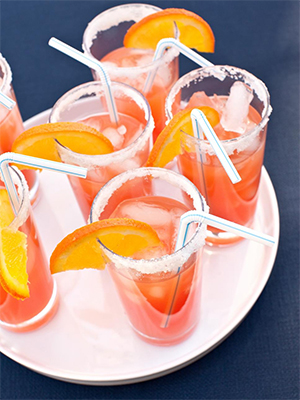 orange drinks against navy background