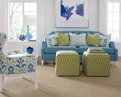 blue colored sofa with legs