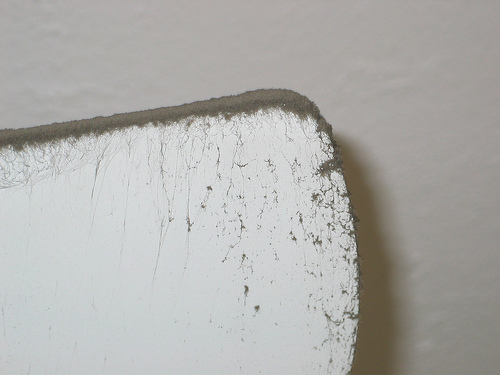 close up of a dusty ceiling fan blade