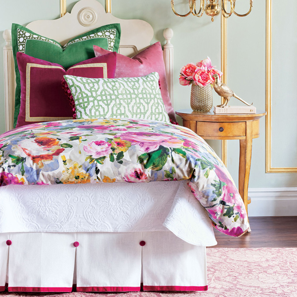bed with floral comforter