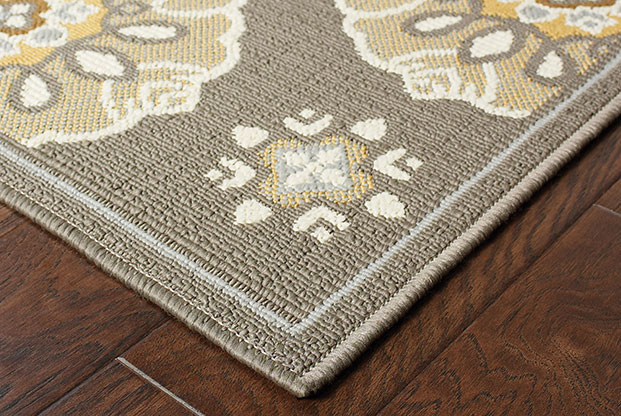 beige rug with floral accents for sunroom